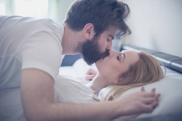gorgeous-young-couple-kissing-in-the-bed-in-the-morning